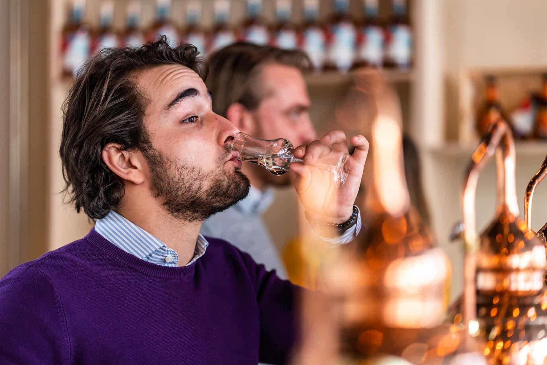 Tasting rum during the distilling class in the spirited union distillery in amsterdam