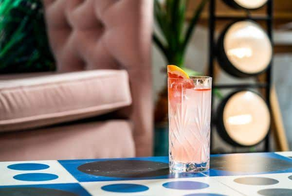 Pretty in pink cocktail with grapefruit soda and Lemon & Leaf Botanical rum