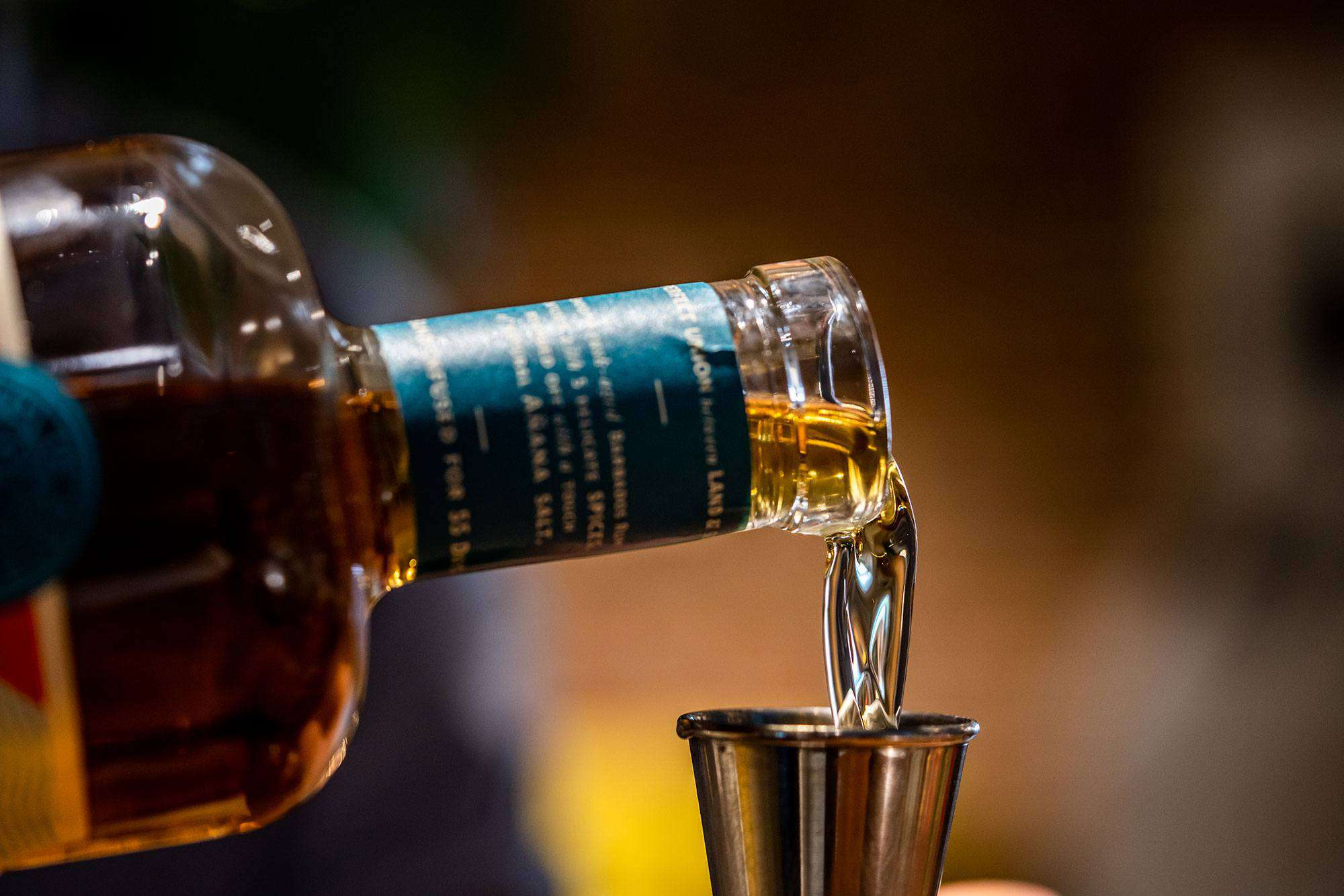 Pouring Spirited Union rum in jigger